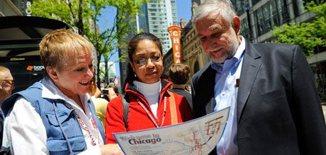 Friendly Chicago Greeters show a visitor a map of Chicago